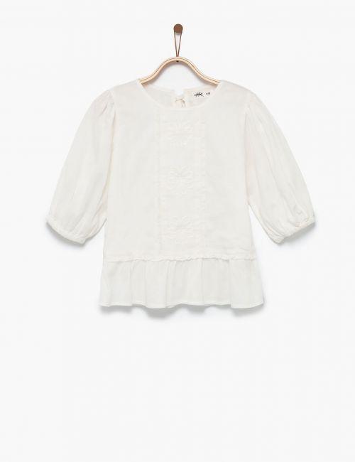 חולצה לבנה עם רקמה ופפלום
